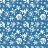 Olika moderna snöflingor på blå bakgrund royaltyfri illustrationer