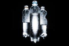 Olika plast- flaskor av vatten Fotografering för Bildbyråer