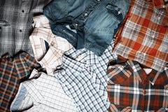 Olika rutiga skjortor Fotografering för Bildbyråer