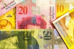 Olika schweizisk franc anmärkningar för pappers- valuta Arkivfoto