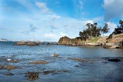 Olika sikter av en strand från en sommarsemesterort i La Coruna skäller Arkivfoton
