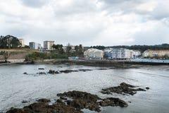 Olika sikter av en strand från en sommarsemesterort i La Coruna skäller Royaltyfri Bild