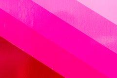 Olika skuggor av rosa färgmålarfärg Arkivfoton