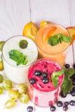 Olika smoothies i exponeringsglas Royaltyfria Bilder
