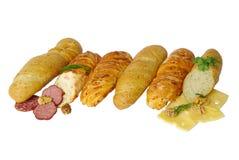 Olika sorter av bagetten med olika fyllningar Arkivbild