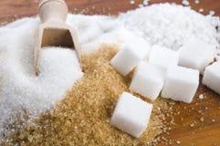 Olika sorter av sockerslutet upp Arkivfoto