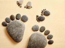 Olika stenar i formen av mänsklig fot Royaltyfria Bilder