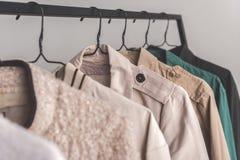Olika typer av överrockar i garderob Royaltyfria Bilder