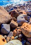 Olika typer av strandstenen Arkivbilder
