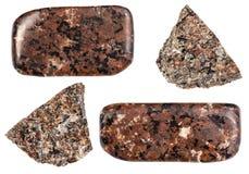 Olika Urtite stenar som isoleras på vit Arkivfoto