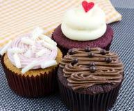 Olika utsmyckade muffin Royaltyfri Foto