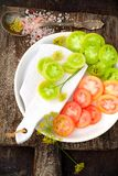 Olika variationer av tomater på svart Royaltyfri Foto