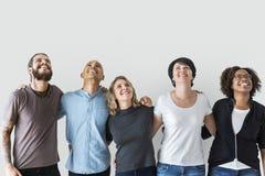 Olikt folk med teamworkbegrepp arkivbilder
