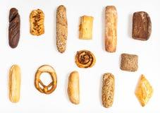 Olikt nytt bageri på vit bakgrund Royaltyfri Foto