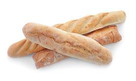 Olikt nytt smakligt bröd på vit bakgrund royaltyfria bilder