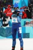 Olimpijski mistrz Martin Fourcade Francja współzawodniczy w biathlon mężczyzna ` s 12 5km pogoń przy 2018 olimpiadami zimowymi obraz royalty free