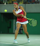 Olimpijski mistrz Monica Puig Puerto Rico w akci podczas tenisowych kobiet przerzedże finał Rio 2016 olimpiad Zdjęcia Stock