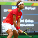 Olimpijski mistrz Rafael Nadal Hiszpania w akci podczas mężczyzna przerzedże wokoło cztery Rio 2016 olimpiad Obrazy Stock