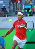 Olimpijski mistrz Rafael Nadal Hiszpania w akci podczas mężczyzna ` s przerzedże półfinału dopasowanie Rio 2016 olimpiad Fotografia Royalty Free