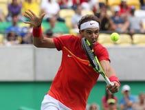 Olimpijski mistrz Rafael Nadal Hiszpania w akci podczas mężczyzna ` s przerzedże półfinału dopasowanie Rio 2016 olimpiad Zdjęcia Stock