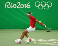 Olimpijski mistrz Rafael Nadal Hiszpania w akci podczas mężczyzna ` s przerzedże pierwszy round dopasowanie Rio 2016 olimpiad Obraz Royalty Free