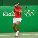 Olimpijski mistrz Rafael Nadal Hiszpania w akci podczas mężczyzna ` s przerzedże pierwszy round dopasowanie Rio 2016 olimpiad Fotografia Royalty Free