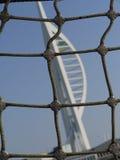 Olinowanie statek z Spinnaka wierza tłem w Portsmouth, Hampshire Zdjęcia Stock