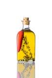 Olio con pepe su fondo bianco Fotografia Stock Libera da Diritti