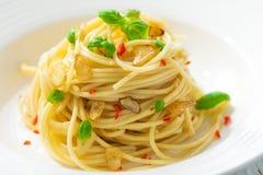 Olio d'oliva e peperoncino di Spageti Fotografia Stock Libera da Diritti