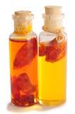 Olio del peperoncino rosso. Isolato immagini stock libere da diritti