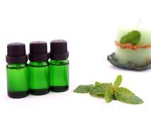 Olio dell'aroma su fondo bianco Immagini Stock