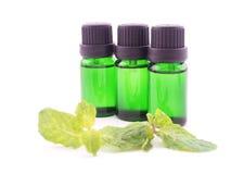 Olio dell'aroma su fondo bianco Immagine Stock