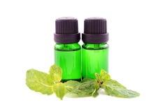 Olio dell'aroma su fondo bianco Fotografie Stock