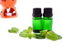 Olio dell'aroma su fondo bianco Fotografia Stock Libera da Diritti