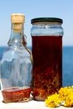 Olio di erbe rosso Fotografia Stock