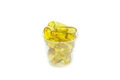 Olio di fegato di merluzzo omega 3 capsule del gel Fotografia Stock