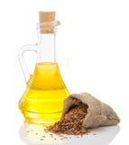 Olio di lino e semi di lino Fotografie Stock