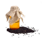 Olio di Nigella con i semi. fotografia stock