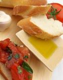 Olio di oliva con gli ingredienti Fotografia Stock