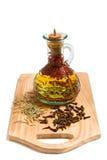 Olio di oliva con spicery Immagine Stock