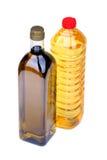 Olio di oliva e bottiglie dell'olio di girasole Immagini Stock