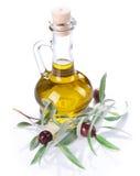 Olio e rami di ulivo di oliva Fotografie Stock