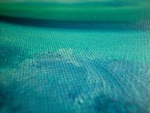 Olio sul particolare di struttura della tela di canapa Fotografie Stock