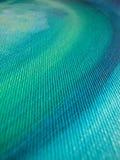 Olio sul particolare di struttura della tela di canapa Fotografia Stock