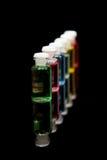 Olio variopinto della bottiglia di aromaterapia Fotografie Stock Libere da Diritti