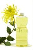 Olio vegetale puro con il fiore Fotografia Stock
