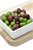 Olive. A plate of olives on white background Royalty Free Stock Images