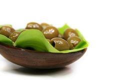 Olive. A few olives in a bowl of lumber on a green leaf Stock Images