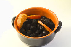 Olive. A black olive and orange Stock Photo