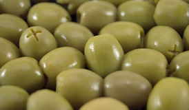 Olive. A ripe green olive closeup royalty free stock image